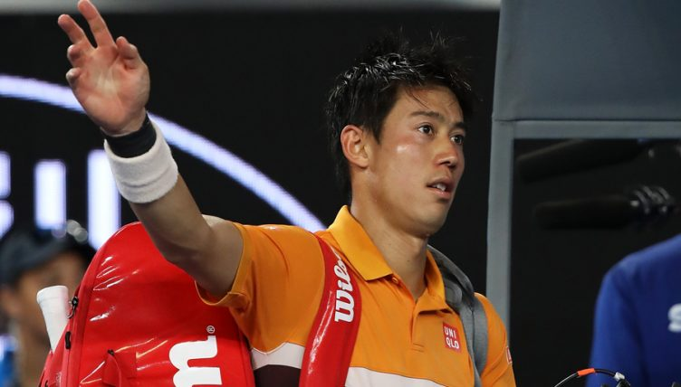 Kei Nishikori walks off court