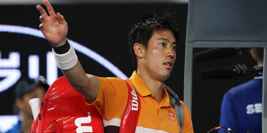 Kei Nishikori walks off court