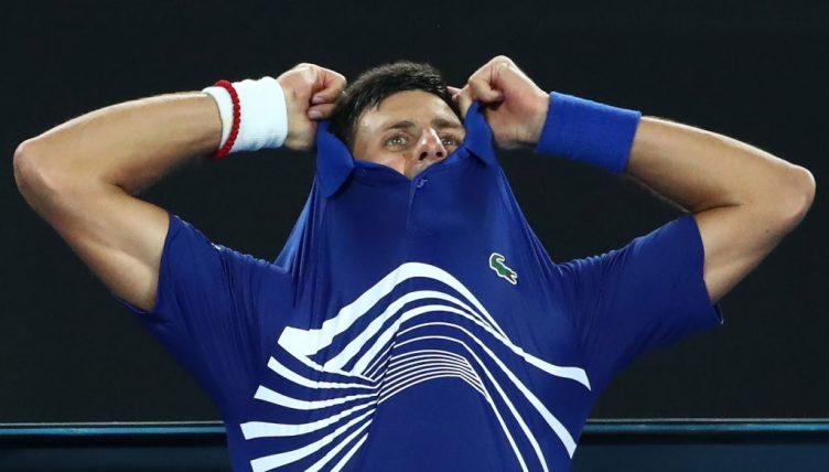 Novak Djokovic takes his shirt off