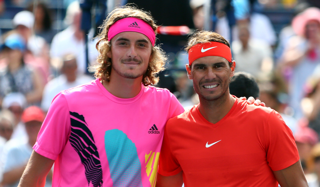 Stefanos Tsitsipas and Rafael Nadal in action