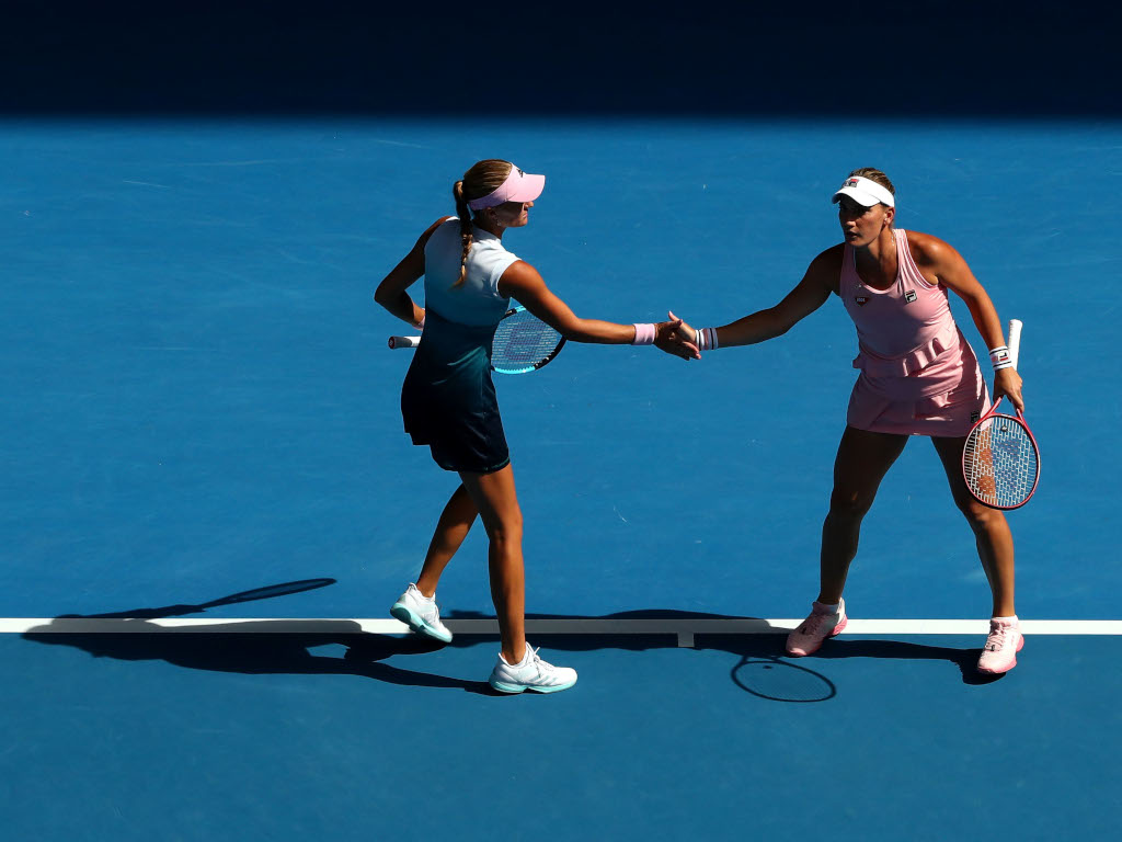 Timea Babos and Kristina Mladenovic in action