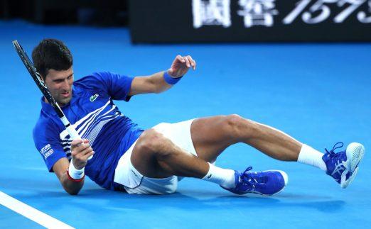 Novak Djokovic hits the floor