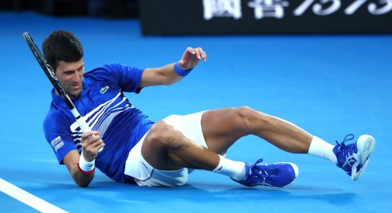Novak Djokovic hits the floor