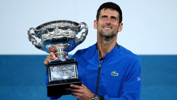 Novak Djokovic poses with Australian Open trophy