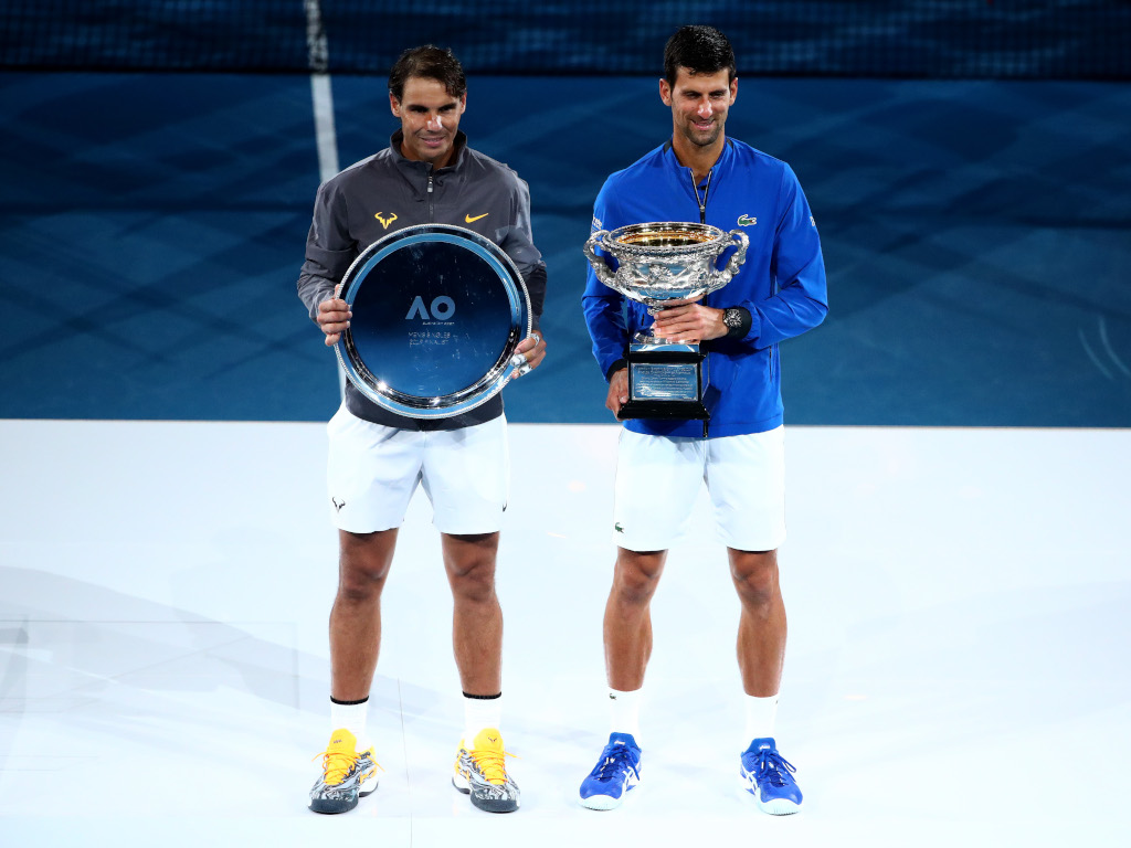 Rafael Nadal and Novak Djokovic with Australian Open trophies