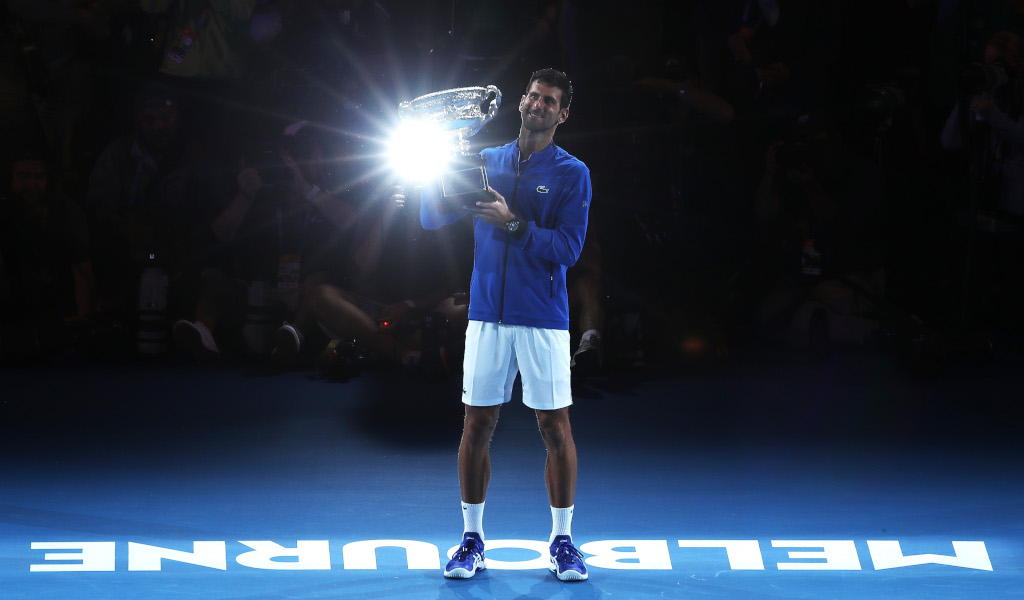 Novak Djokovic poses with Australian Open trophy