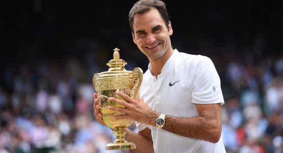 Roger Federer with 2017 Wimbledon trophy