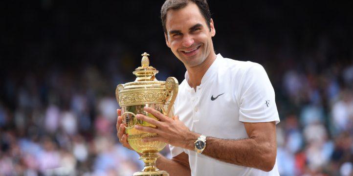 Roger Federer with 2017 Wimbledon trophy
