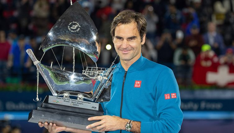 Roger Federer with Dubai trophy PA