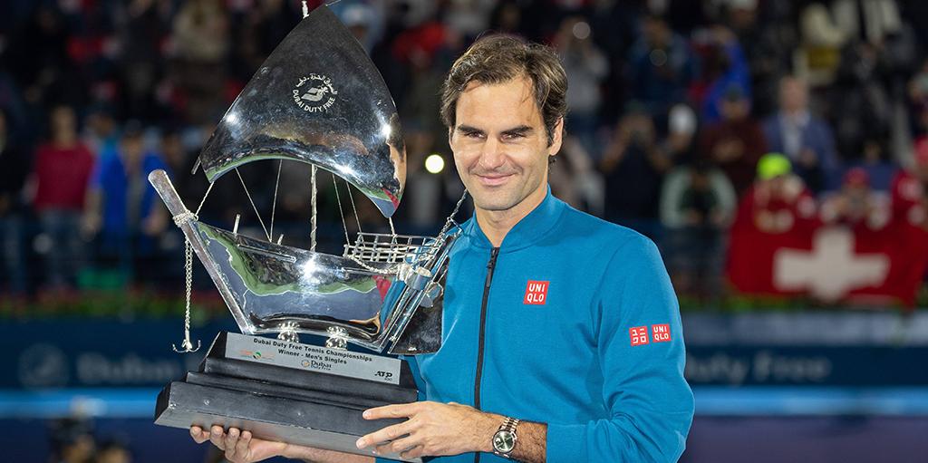 Roger Federer with Dubai trophy PA