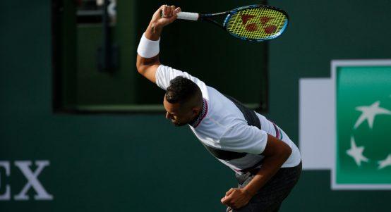 Nick Kyrgios smashes his racket