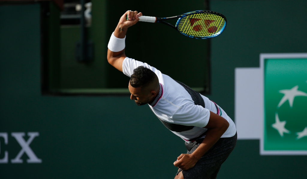 Nick Kyrgios smashes his racket