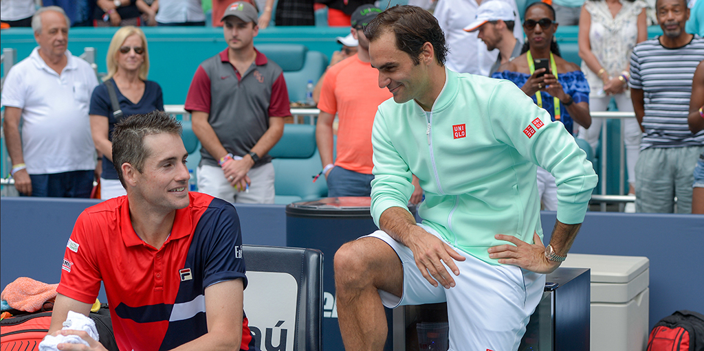 Roger Federer with John Isner after Miami Open final PA