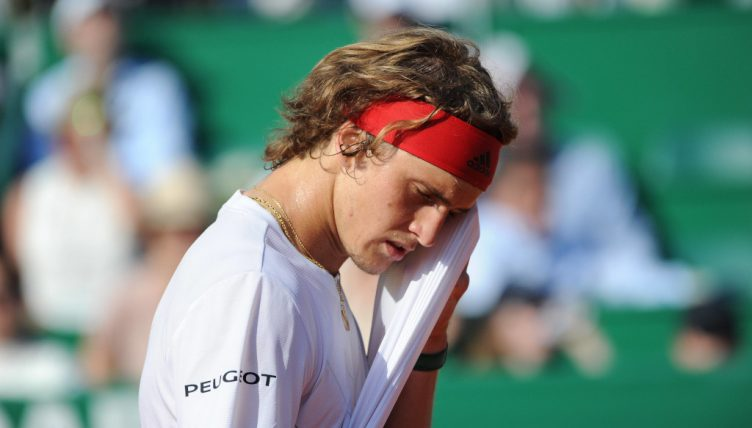 Alexander Zverev wiping his face