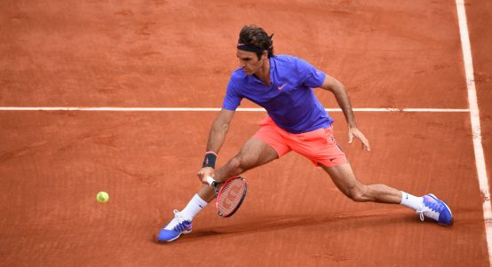 Roger Federer sliding on clay