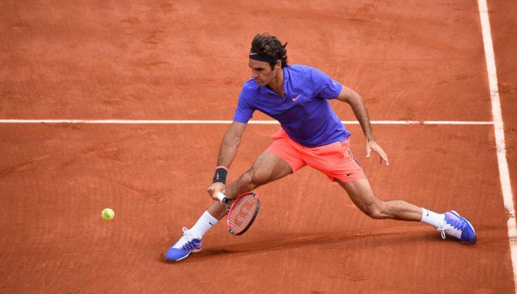 Roger Federer sliding on clay