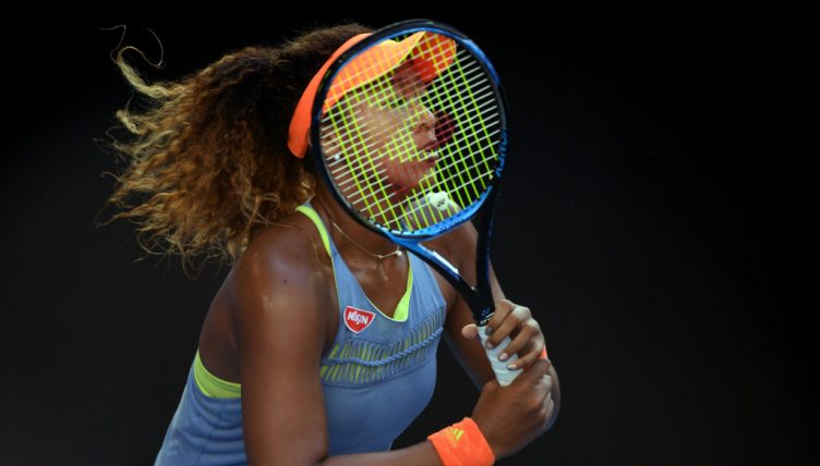 Naomi Osaka behind the racket
