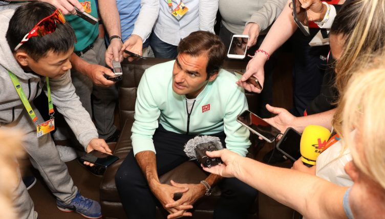 Roger Federer talking to the media