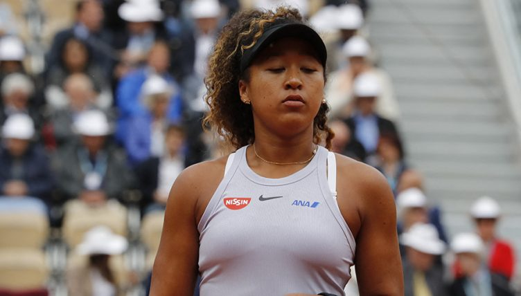Naomi Osaka looks dejected at French Open PA