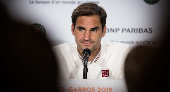 Roger Federer speaks to the media