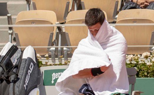 Novak Djokovic wrapped in a towel