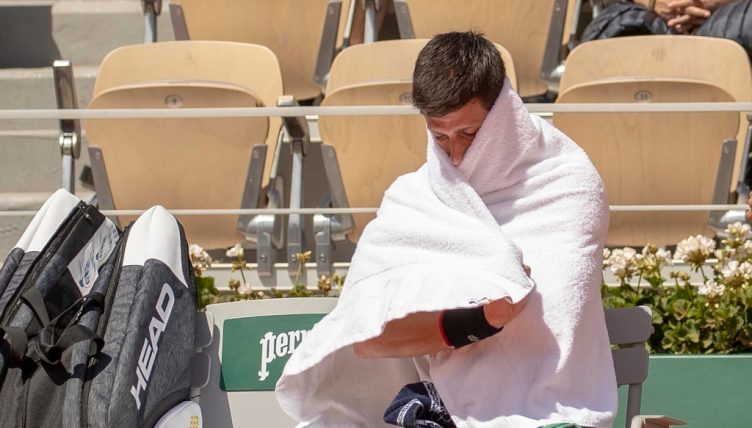 Novak Djokovic wrapped in a towel