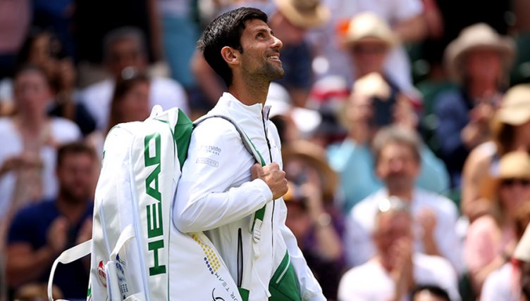Novak Djokovic walking out at Wimbledon