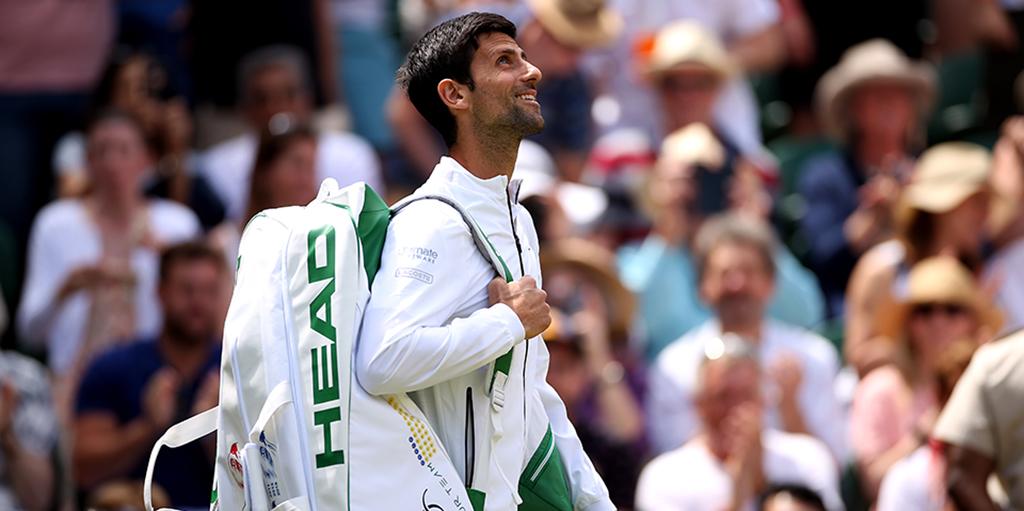 Novak Djokovic walking out at Wimbledon