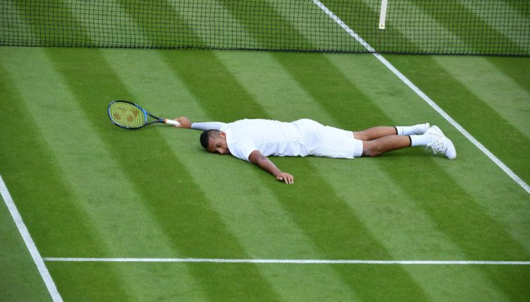 Nick Kyrgios hits the floor