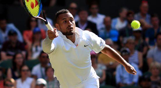 Nick Kyrgios reaches for ball at Wimbledon
