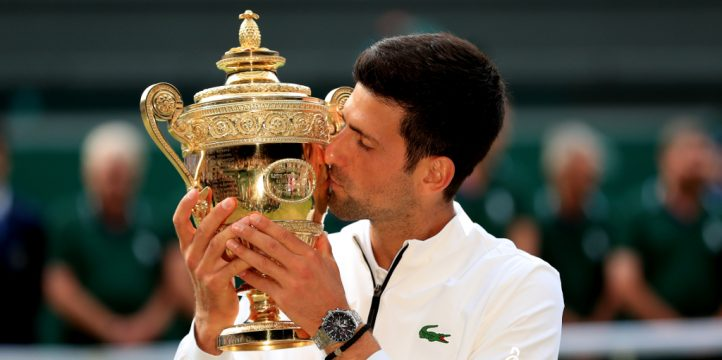 Novak Djokovic kisses Wimbledon trophy