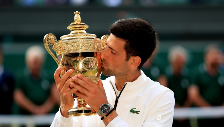 Novak Djokovic kisses Wimbledon trophy