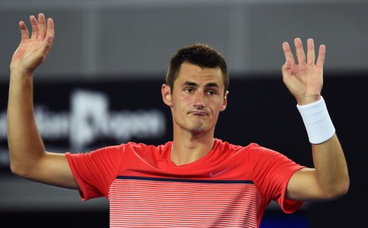 Bernard Tomic hands up