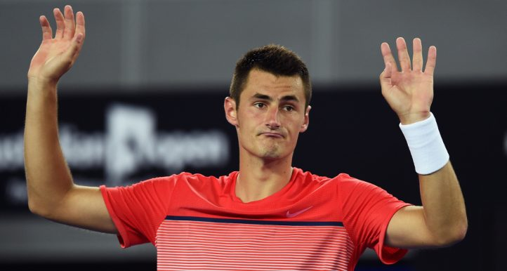 Bernard Tomic hands up