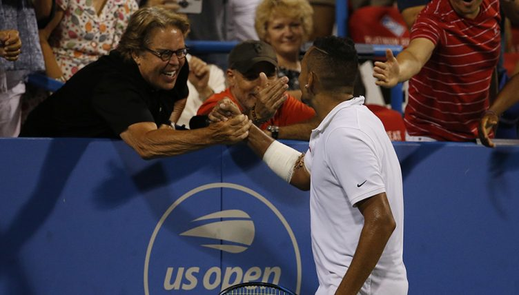 Nick Kyrgios with fan after successful serve
