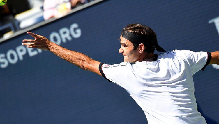 Roger Federer serving at US Open