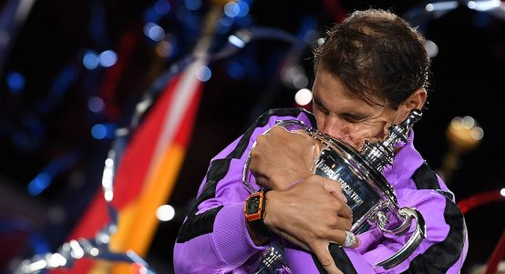 Rafael Nadal hugging US Open trophy