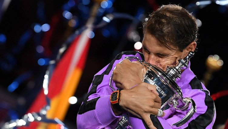 Rafael Nadal hugging US Open trophy