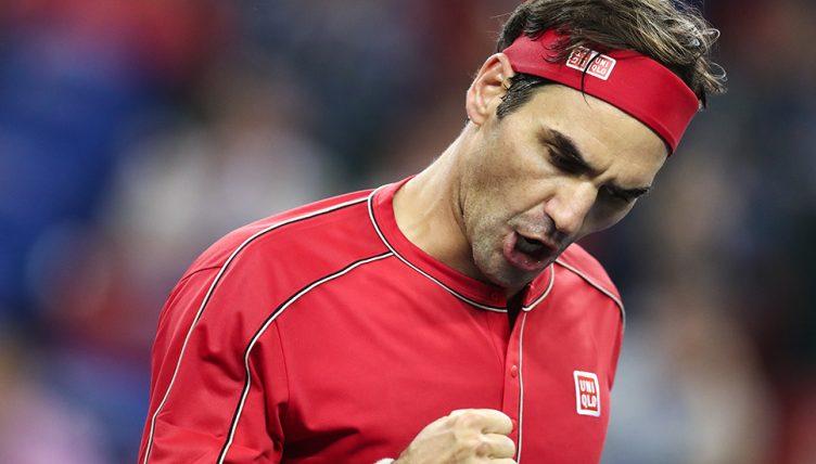 Roger Federer celebrates in Shanghai