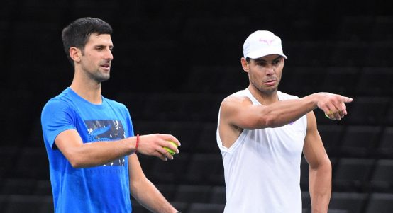 Novak Djokovic and Rafael Nadal pointing