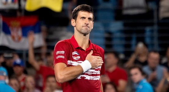 Novak Djokovic with hand on heart