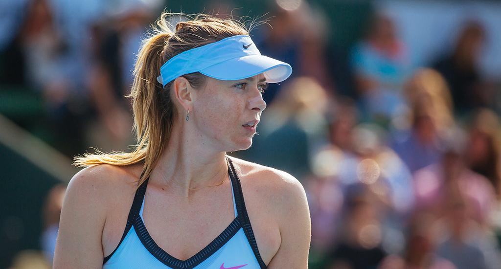 Maria Sharapova looking on