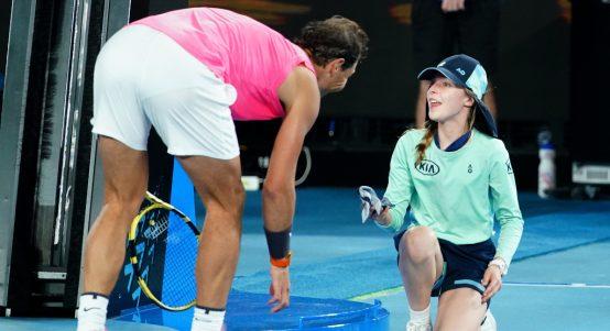 Rafael Nadal comforts ball girl