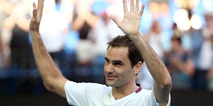 Roger Federer applauds the crowd