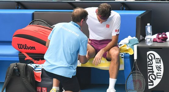 Roger Federer receiving treatment