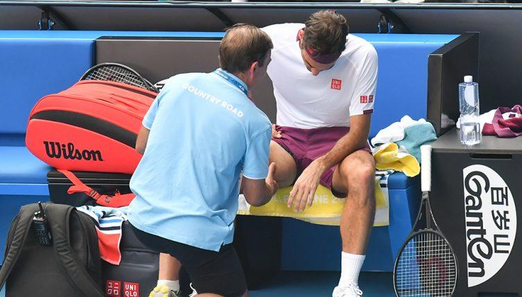 Roger Federer receiving treatment