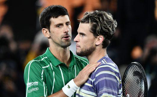 Dominic Thiem consoled by Novak Djokovic