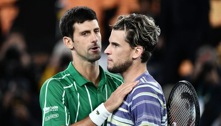 Dominic Thiem consoled by Novak Djokovic