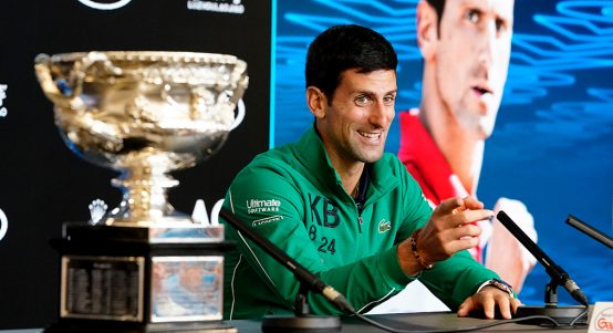 Novak Djokovic laughing at Australian Open press conference