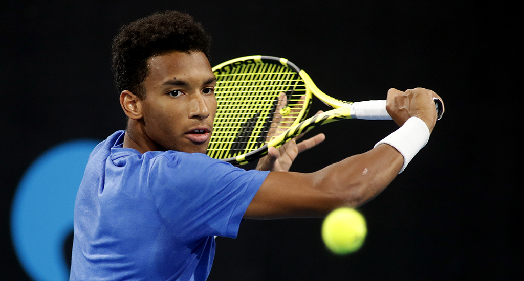 Felix Auger-Aliassime in action